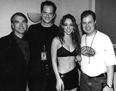 "Mariah Carey at Z100/New York's Z-Day celebration in 1998. (l-r): VP/GM John Fullam, PD Tom Poleman, Mariah Carey, and MD Paul ""Cubby"" Bryant."
